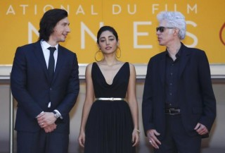 "Director Jim Jarmusch cast members Adam Driver and Golshifteh Farahani pose on red carpet while arriving for the screening of the film ""Paterson"" in competition at the 69th Cannes Film Festival in Cannes"